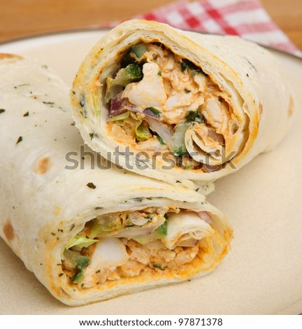 Chicken tikka wrap sandwich with yoghurt and mint dressing.