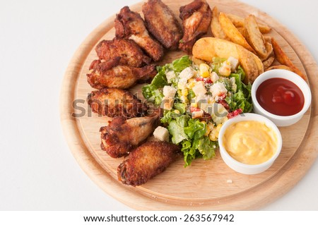 chicken wing  with potatoes and salad - stock photo