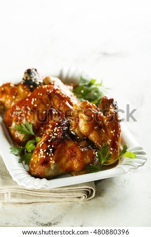 Chicken wings in maple syrup glaze with sesame seeds