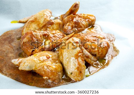 chicken wings in the marinade - stock photo