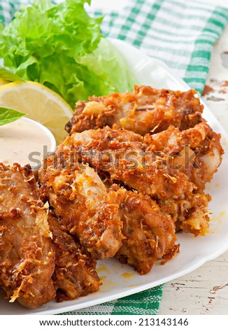 Chicken wings with parmesan cheese in the oven