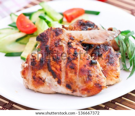 Chicken wings with salad - stock photo