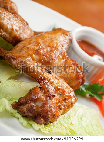 chicken wings with vegetable closeup - stock photo