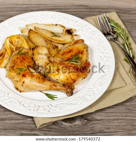 Chicken with Garlic, Lemon and Rosemary. Selective focus. - stock photo