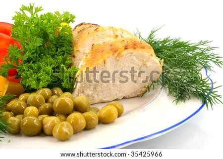 chicken with raw vegetables and greens on plate. stock photo - stock photo