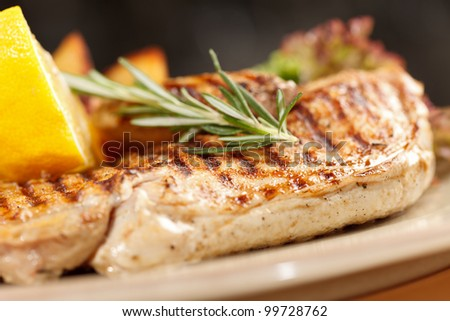 chicken with roasted potatoes - stock photo