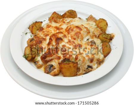 Chicken with sauce from yellow cheese and potatoes
