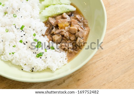 Chicken with sauce over rice