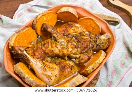 Chicken with sweet potatoes baked in traditional old roman pot - stock photo