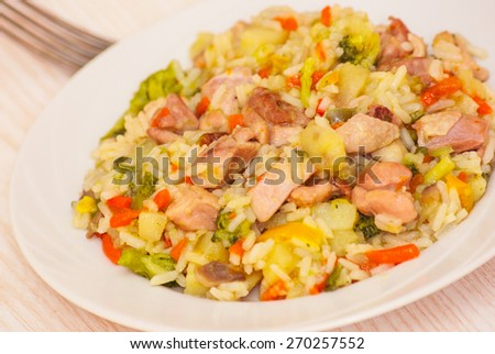 chicken with vegetables and rice - stock photo