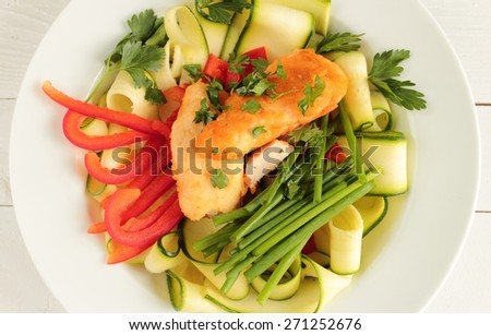 Chicken with zucchini, red paprika and fresh chive - stock photo