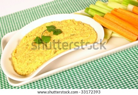 Chickpea hummus with mexican parsley and carrots and celery for dipping - stock photo