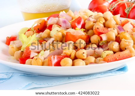 Chickpea salad is a summertime favorite as a side dish or main course for vegetarians at your bbq - stock photo
