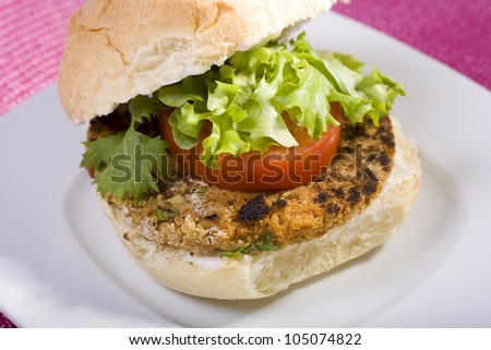 Chickpea Vegan Veggie Burger on a Kaiser Roll with Lettuce Tomato and Vegan Mayo