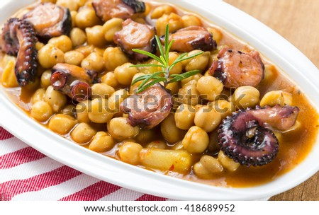 Chickpeas and octopus - stock photo
