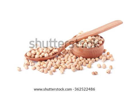 Chickpeas in a wooden spoon and a wooden plate on a white background - stock photo