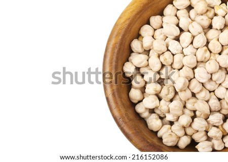 Chickpeas in wooden bowl isolated on white - stock photo