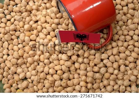 Chickpeas or Garbanzo Beans With Albania Flag - stock photo