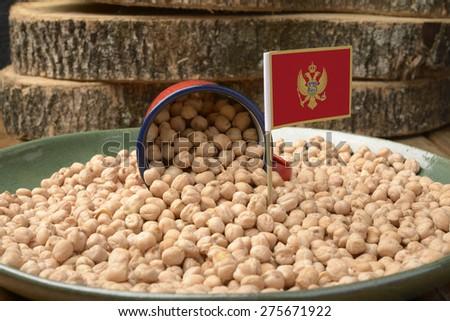 Chickpeas or Garbanzo Beans With Montenegro Flag - stock photo