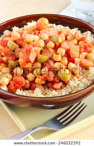 Chickpeas, tomatoes and couscous vegetarian meal or side dish - stock photo
