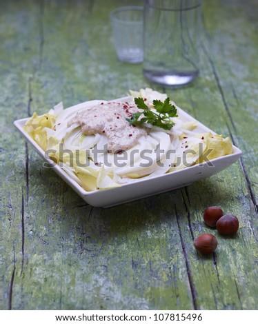Chicory-endive salad with tuna cream - stock photo