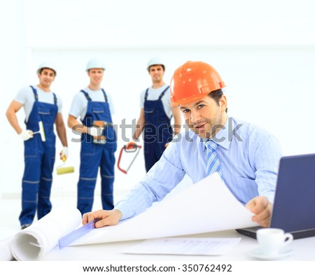 chief architect and his team in the background - stock photo
