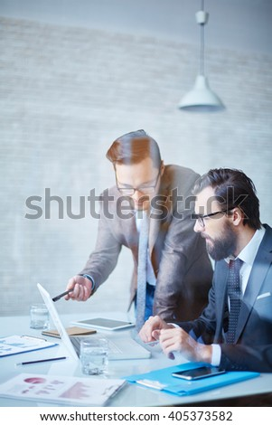 Chief explaining some things to his worker - stock photo