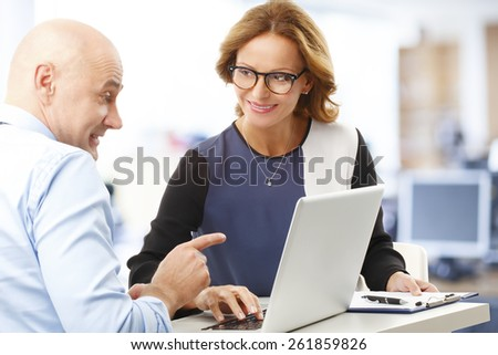 Chief financial officer analyzing financial data with business woman. Teamwork at office.  - stock photo