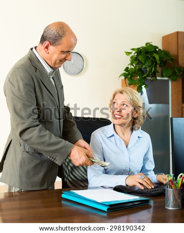 Chief paying to happy assistant an yearly bonus in office