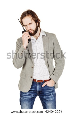 Chief security officer communicating through his walkie talkie. Security agent surveillance guard isolated on white background. - stock photo