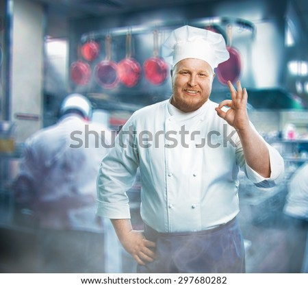 Chief working on the kitchen - stock photo