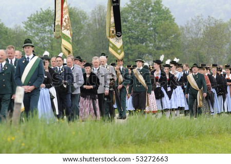 CHIEMGAU, GERMANY - MAY 13: yearly catholic procession with pilgrims in traditional bavarian costume, May 13, 2010 in Chiemgau, Germany, Bavaria - stock photo