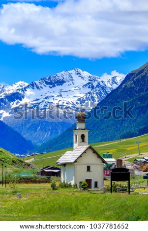 Chiesa dell Immacolata di Viera church with Italian alps mountain as background. Located in Livigno, Provincia di Sondrio, Lombardia, Italy.