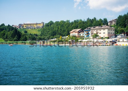 CHIESA, ITALY - JULY 18, 2014: Tourists enjoying Lavarone Lake on a sunny day. This is a locality famous for its lake in the italian region of Trentino Alto Adige.