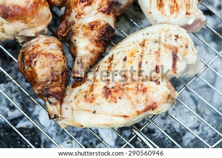 Chiken on the grill - paleo food photography with shallow depth of field. - stock photo