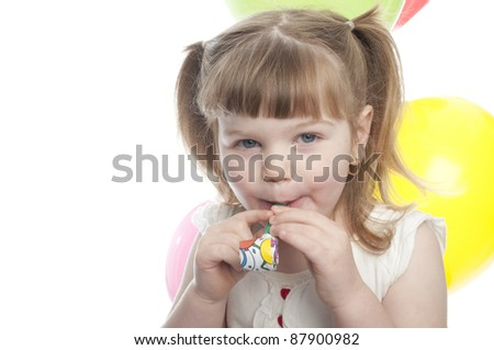 child about to blow on a party blower