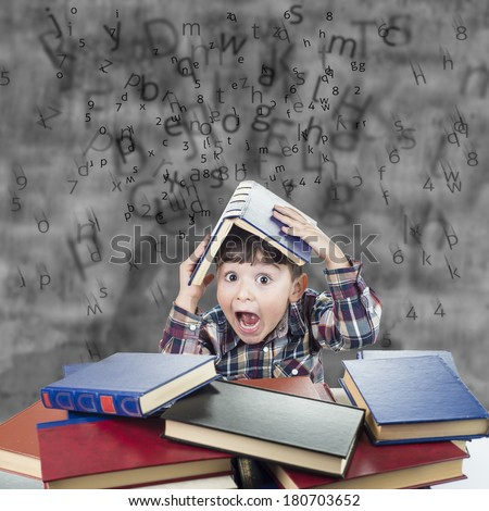 Child against the rain of numbers and letters with a book over his head - stock photo