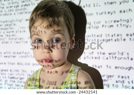 Child an text projection device - stock photo