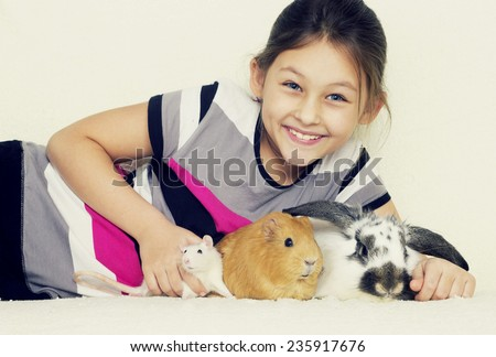 child and a set of rodents, guinea pig, rabbit, rat - stock photo