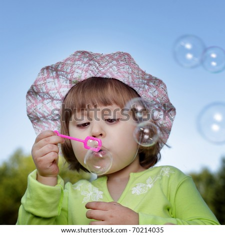 child and bubble outdoors - stock photo