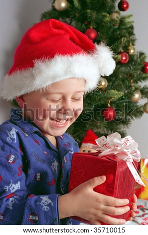 child and christmas gifts - stock photo