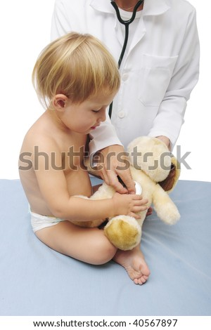 child and doctor examining a teddy-bear