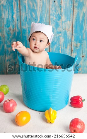 Child and fresh fruit. Concept: healthy vegetable food diet make baby strong and happy - stock photo