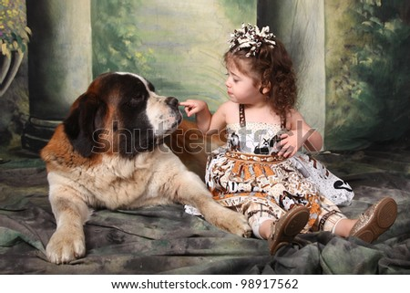 Child and Her Saint Bernard Puppy Dog - stock photo