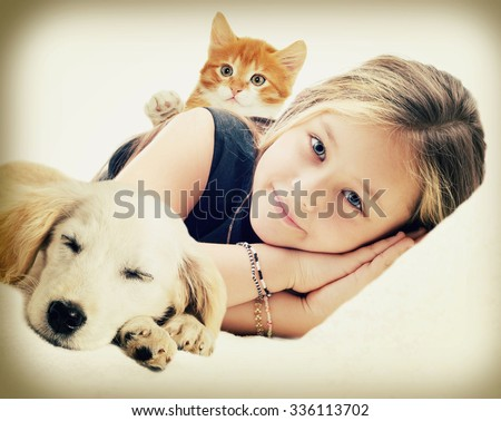 Child and kitten and puppy - stock photo