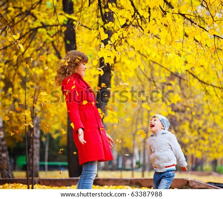 child and mother closed their eyes with autumn leaves