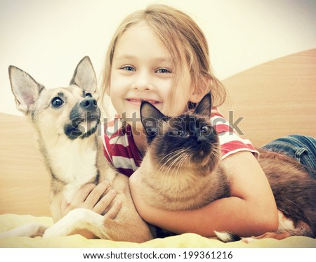 child and pet - stock photo