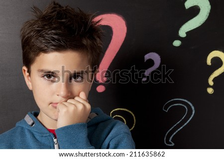 child and questions marks - stock photo