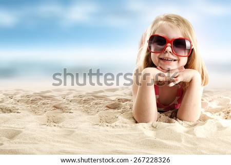 child and sand with sky