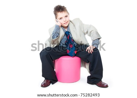 child as a business man talking on the phone - stock photo